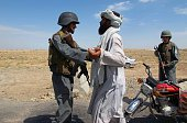An Afghan policeman searches a passenger at a checkpoint in Lashkar Gah city capital of Helmand province on July 30 2015 The Taliban on July 30...