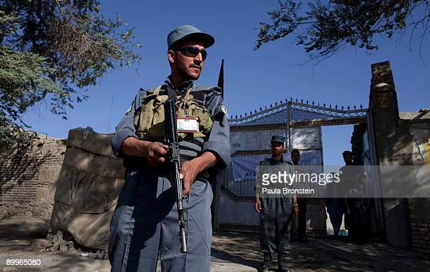 An Afghan policeman stands guard outside a polling station August 20 2009 in Kabul Afghanistan Afghans voted Thursday to elect a president for the...