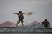 TOPSHOT An Afghan Quick Reaction Force soldier fires a rocketpropelled grenade launcher during an operation near the Indian consulate in MazariSharif...