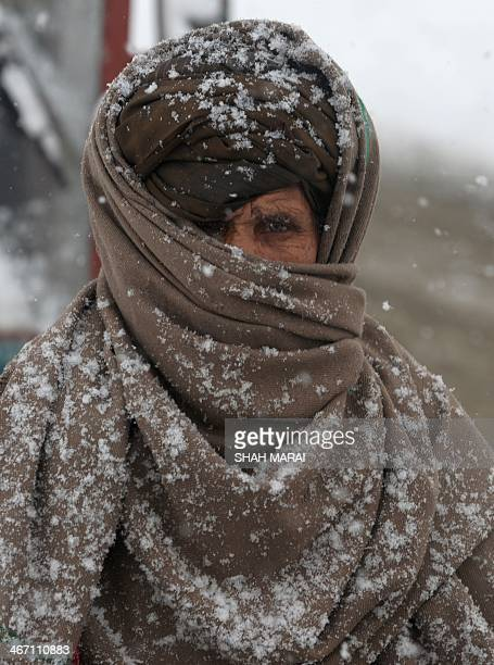 An Afghan resident walks during snowfall in Kabul on February 6 2014 The Afghan capital has experienced its second heavy snowfall of the winter AFP...