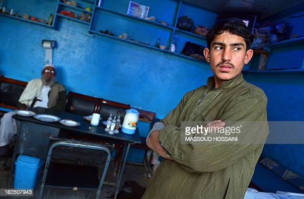 An Afghan restaurant employee looks on while waitinf for customers in Kabul on February 24 2013 The wartorn country beset by a decadelong Taliban...