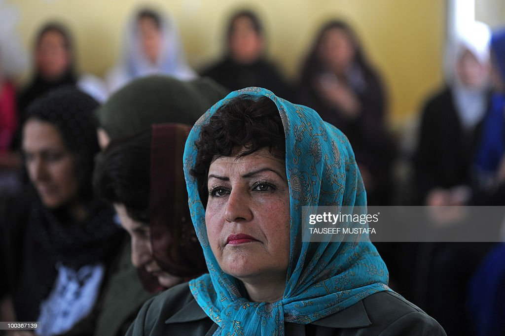 An Afghan school teacher looks on during a World Teacher's Day function at a school in central Kabul on May 24, 2010. Afghanistan has been suffering some sort of armed conflict for the past 30 years, starting with the Soviet invasion of 1979, through civil war and, from 1996-2001, rule by the Islamist Taliban who banned girls from education. This has left a huge knowledge gap that the international community has been trying to fill, with billions of dollars of aid pouring in since the Taliban were pushed out in a US-led invasion. AFP PHOTO/Tauseef MUSTAFA