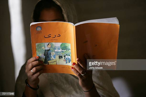 An Afghan schoolgirl reads aloud during class October 8 2006 near Puli Alam in Logar Province Afghanistan Taliban fighters in recent months have...