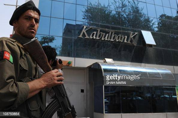 An Afghan security guard keeps watch in front of the Kabul Bank in Kabul on September 1 2010 Afghanistan's central bank governor said that the...