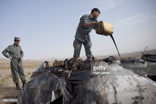 An Afghan security officer prepares confiscated opium to be destoyed November 3 2010 in Herat Afghanistan The opium was confiscated by security...