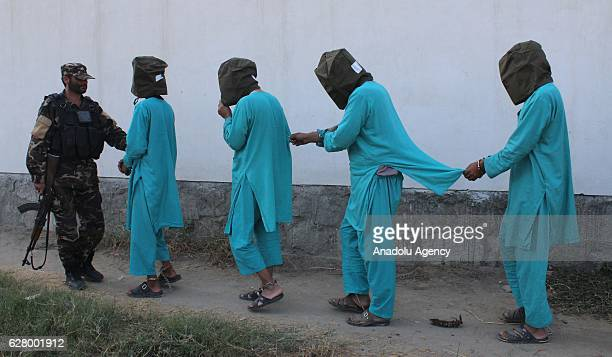 An Afghan security official carries members of Daesh and taliban militants in Jalalabad eastern Afghanistan on December 06 2016 National Directorate...