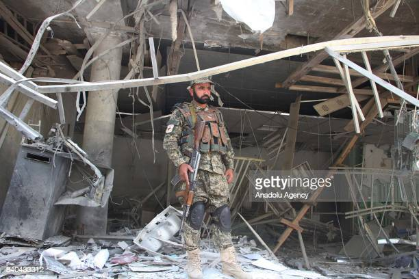 An Afghan security official inspects the building of Kabul bank after a suicide bomb attack in Kabul Afghanistan on August 29 2017 At least 5 people...