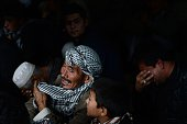 An Afghan Shiite Muslim devotee cries during Ashura commemorations at a mosque in Kabul on October 31 2014 Ashura mourns the death of Imam Hussein a...