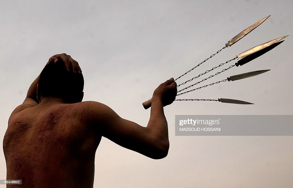 An Afghan Shiite Muslim man beats himself with chains during Ashura at a Shiite mosque in Kabul on December 27 2009 Ashura is a period of mourning in...