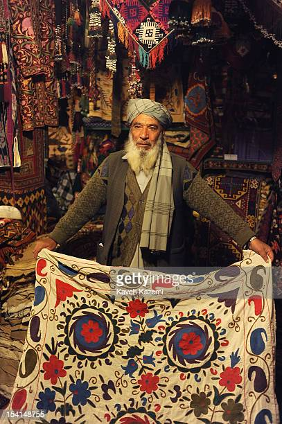 An Afghan shopowner selling Afghan carpets and rugs seen in his shop in Chicken Street on October 17 2011 in Kabul Afghanistan Chicken Street has...