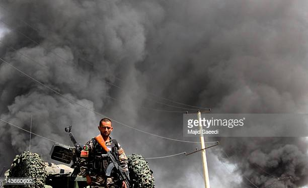 An Afghan soldier attends the scene of a suicide bomb attack on 02 May 2012 in Kabul Afghanista A suicide bomber detonated his vehicle packed with...