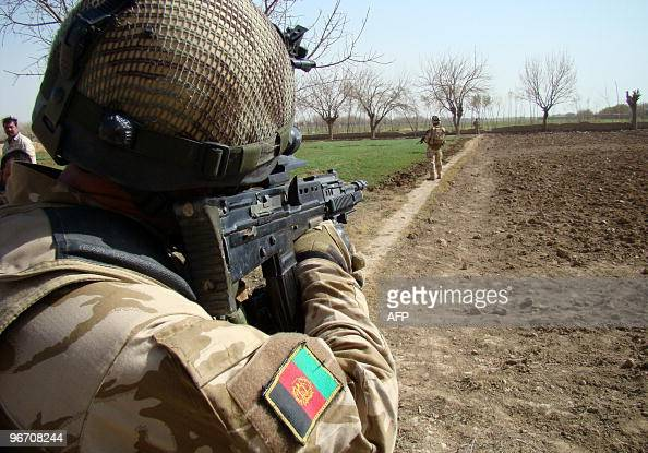 An Afghan soldier keeps in Helmand province during the third day of joint Operation Moshtarak on February 15 2010 The Afghan military said February...