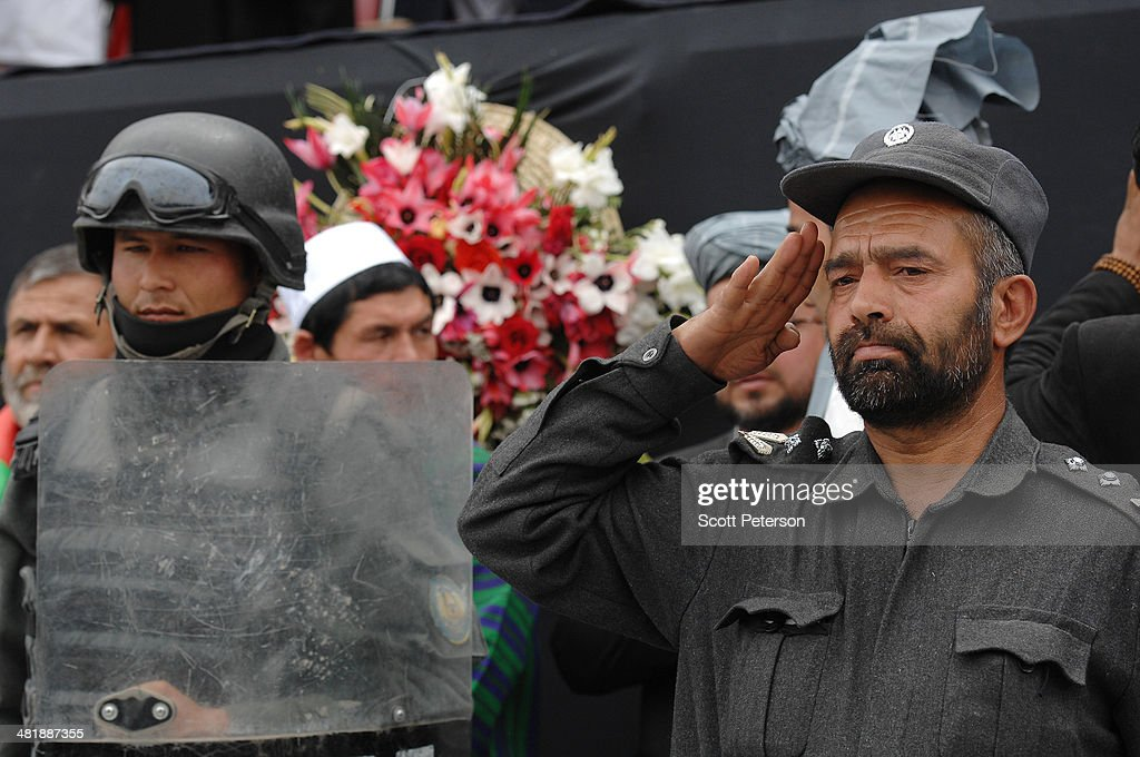 An Afghan soldier salutes as Presidential Candidate Ashraf Ghani Ahmadzai holds a rally for thousands of supporters at the Ghazi stadium on April 1, 2014 in Kabul, Afghanistan. Mr. Ghani is a frontrunner in the April 5 vote to succeed President Hamid Karzai, in an election that is seen as a test of stability that will ensure continued Western donor aid for a nation torn by a Taliban insurgency. The Ghazi stadium is known as the site of amputations and executions during Taliban rule in the late 1990s.