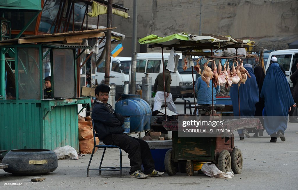 An Afghan street vendor looks on as he waits for customers in Kabul on February 13, 2016. AFP PHOTO / Noorullah Shirzada / AFP / Noorullah Shirzada
