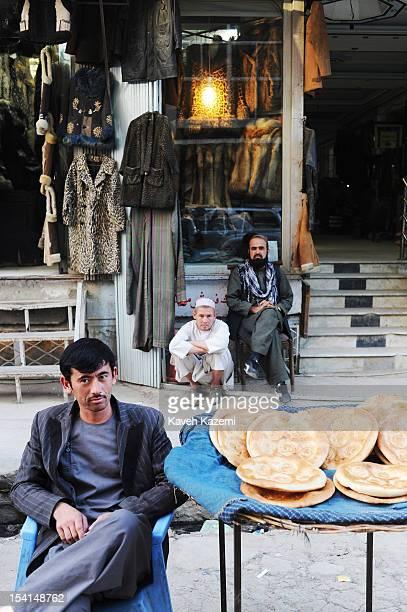 An Afghan street vendor sells baked bread in Chicken Street on October 17 2011 in Kabul Afghanistan Chicken Street has been a focus for Afghanistan's...