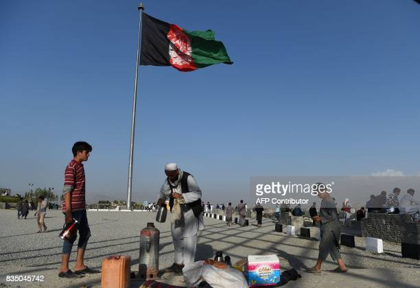 An Afghan tea vendor prepares tea for his customers at the top of the Wazir Akbar Khan hilltop in Kabul on August 18 ahead of Afghan Independence Day...