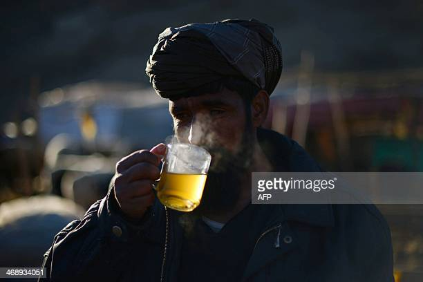 An Afghan trader drinks tea in Kabul on February 12 2014 Afghanistan's economy is recovering from decades of conflict improving significantly since...