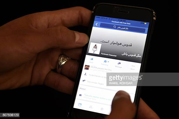An Afghan university student looks at an Afghan variation of the 'Be Like Bill' Internet meme on a Facebook account at Kardan university in Kabul on...