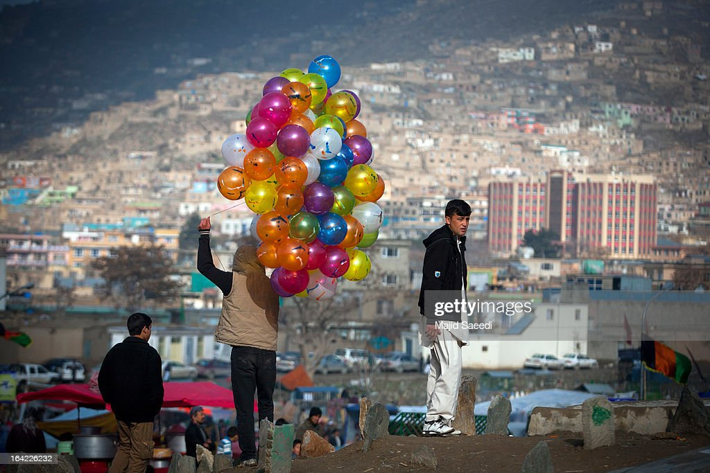 An Afghan vendor sells balloons near the Sakhi shrine, which is the centre of the Afghanistan new year celebrations during the Nowruz festivities on March 21, 2013 in Kabul, Afghanistan. Nowruz is an ancient festival which marks the beginning of the spring equinox and the start of the year in the Iranian calendar, which this coming year will be 1392.