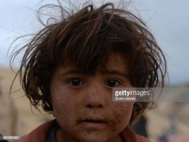 An Afghan villager looks on in Argo district of Badakhshan province on May 3 2014 after a massive landslide May 2 buried a village Rescue teams...