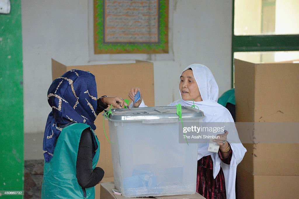 An Afghan woman casts her vote at a polling station on June 14, 2014 in Kabul, Afghanistan. Polling stations have opened across Afghanistan as Afghans head to the polls for the second and final round of voting to elect Hamid Karzai's successor, in a run-off between former foreign minister Abdullah Abdullah and former World Bank economist Ashraf Ghani.