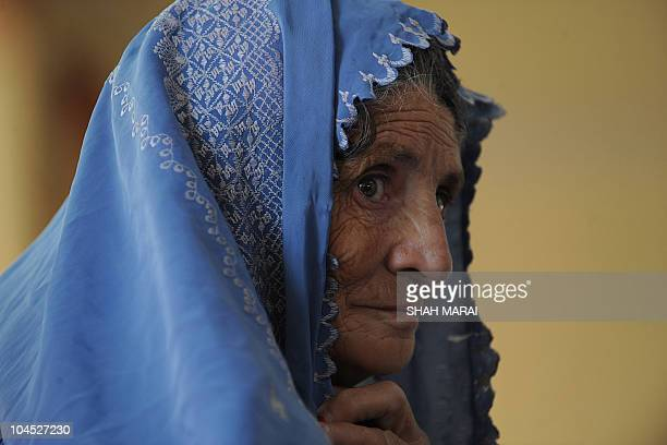 An Afghan woman leaves after casting her vote at a polling station in Kabul on September 18 2010 Afghanistan was voting for a new parliament...