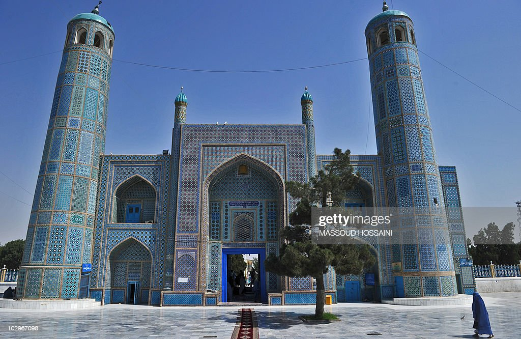 An Afghan woman walks at the Rawze Sharif shrine in northern Mazare Sharif city in Balkh province on July 16 2010 Also known as the Blue Mosque it is...