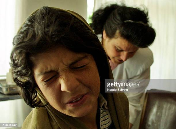 An Afghan Woman Winces As She Receives A Painful Injection To Treat Cutaneous Leishmaniasis A Disfiguring And Disabling Skin Disease In A Clinic May...
