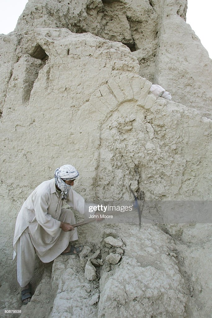 An Afghan worker from a French archaeological team excavates an ancient wall on October 12 2006 at Balkh Afghanistan The French Archaeological...