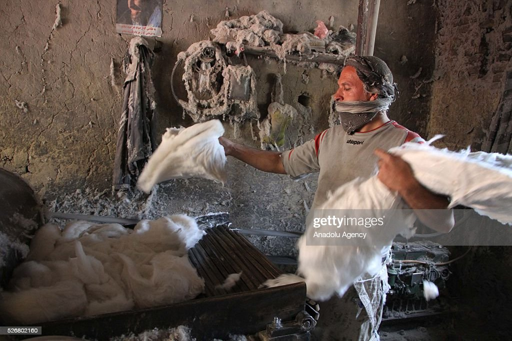An Afghan worker is seen as he works at a cotton factory as the world marks International Labor Day, also known as May Day in Kabul, Afghanistan, on May 1, 2016.