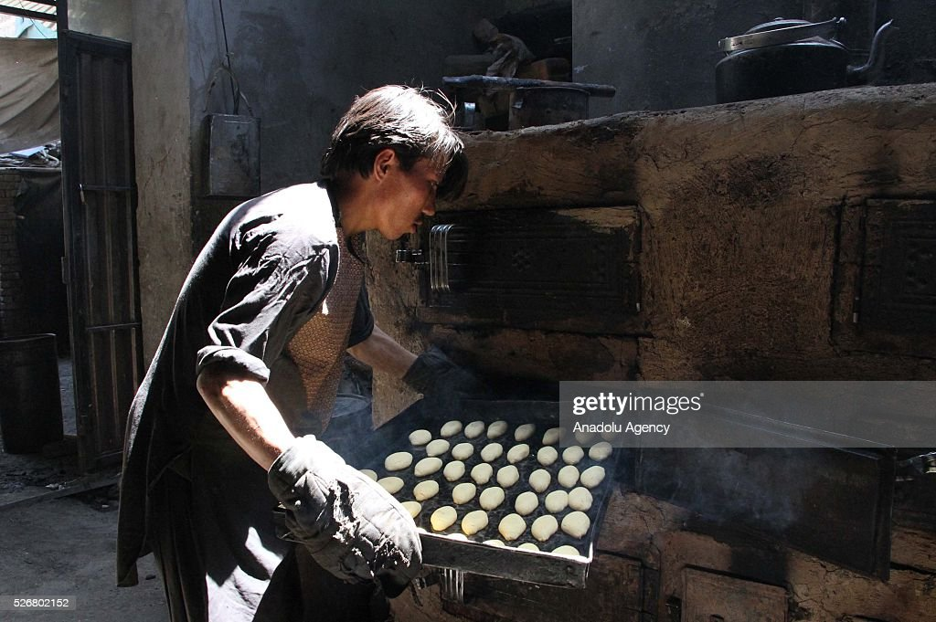 An Afghan worker is seen as he works at a traditional sweet factory as the world marks International Labor Day, also known as May Day in Kabul, Afghanistan, on May 1, 2016.