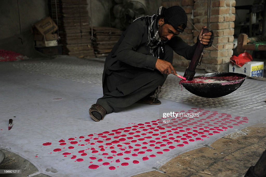 An Afghan worker prepares traditional sweets at a factory on the outskirts of Jalalabad on November 25, 2012. The economy of Afghanistan can be categorized as poor and unstable as it lacks proper industrialization and there is a lack of well-developed manufacturing and infrastructure facilities, and it is dependent on foreign aid and assistance. AFP PHOTO/Noorullah Shirzada