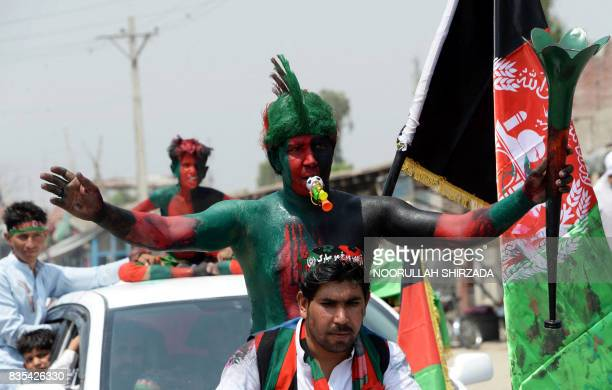 An Afghan youth with the colours of the national flag painted on his body takes part in celebrations to mark the country's Independence Day in...