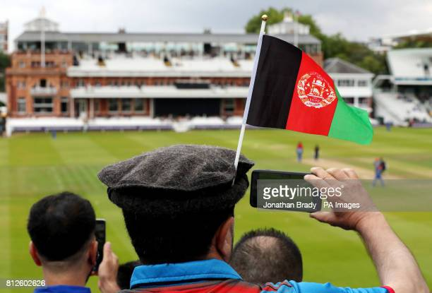 An Afghanistan cricket fan wears his national flag in his hat with the pavilion in the distance during the one day match between MCC and Afghanistan...