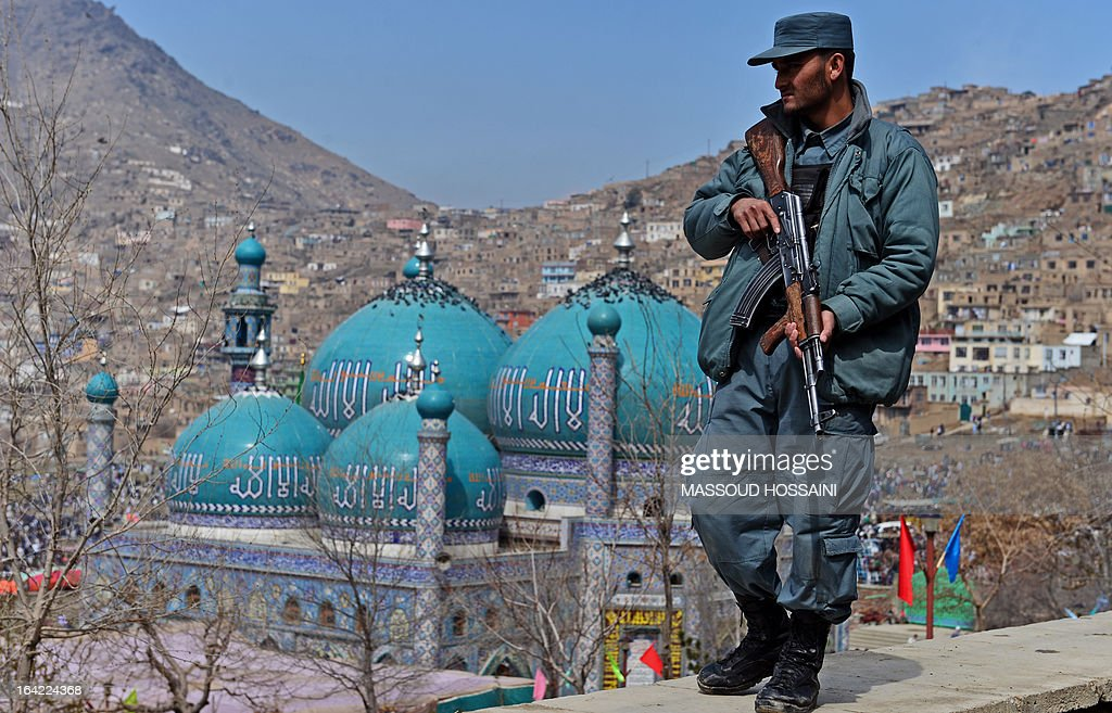 An Afghanistan policemen stands guard near the Sakhi shrine, the centre of the Afghanistan new year celebrations in Kabul during Nowruz festivities on March 21, 2013. Nowruz, one of the biggest festivals of the war-scarred nation, marks the first day of spring and the beginning of the year in the Persian calendar. Nowruz is calculated according to a solar calendar, this coming year marking 1392. AFP PHOTO/ Massoud HOSSAINI