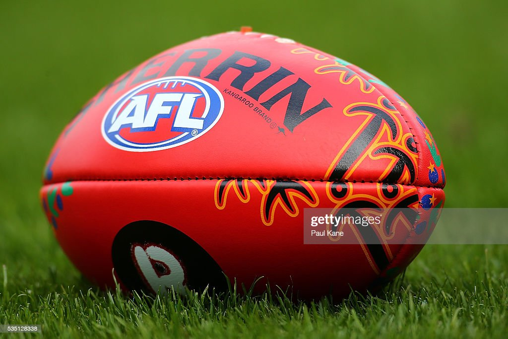 An AFL match ball with indigenous markings is seen during the round 10 AFL match between the West Coast Eagles and the Gold Coast Suns at Domain Stadium on May 29, 2016 in Perth, Australia.