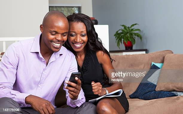 An African American couple looking at phone