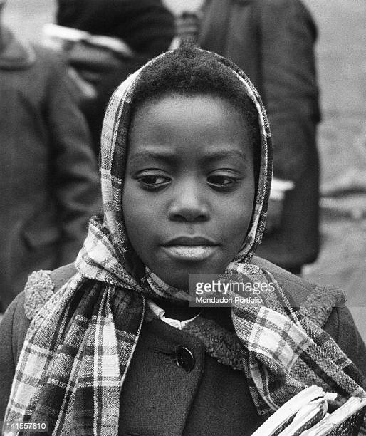 An African American girl wearing a head scarf in a Harlem street New York February 1956