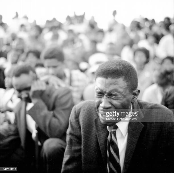 An African American man breaks down during a protest against segregation organized by Reverend Dr Martin Luther King Jr and Reverend Fred...