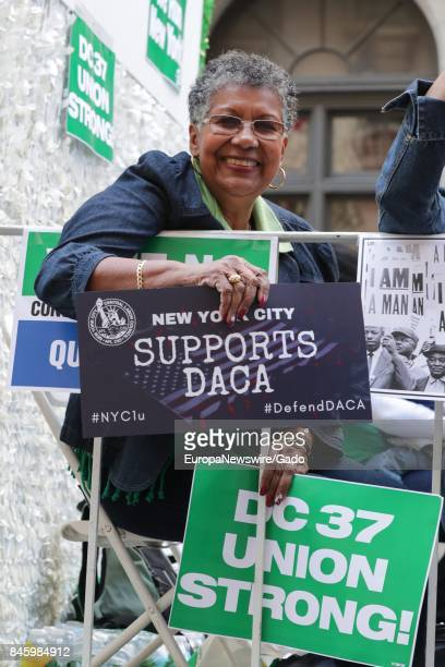 An African American woman smiles and holds a sign in support of Deferred Action of Childhood Arrivals during the 2017 Labor Day Parade on Fifth...