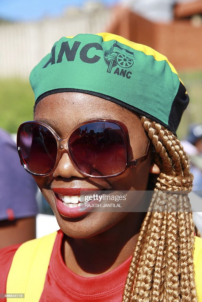 An African National Congress (ANC) female member wears colourful ANC regalia during a march organised by the Congress of South African Trade Unions (COSATU) to support the ruling ANC party in Durban, on April 26, 2014. COSATU (South Africa's largest trade union comprising of over 2 million workers) and the SACP are in a tripartite alliance with the ANC, and have declared their support to the ANC in the upcoming elections on May 7, 2014.