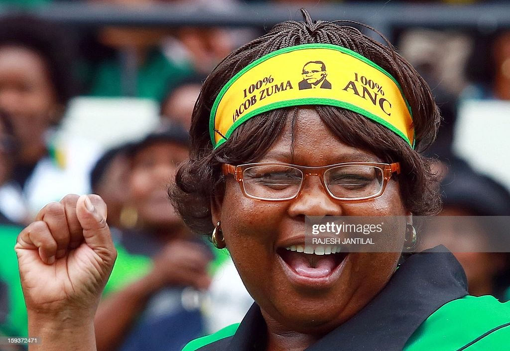 An African National Congress (ANC) supporter peforms a 'toyi toyi' dance during a event commemorating the 101st birthday of the ANC party in Durban on January 12, 2013. Close to 50 000 ANC supporters attend the massive rally to listen South Africa's President and ANC leader Jacob Zuma delivering the January 8th statement on behalf of the ANC.