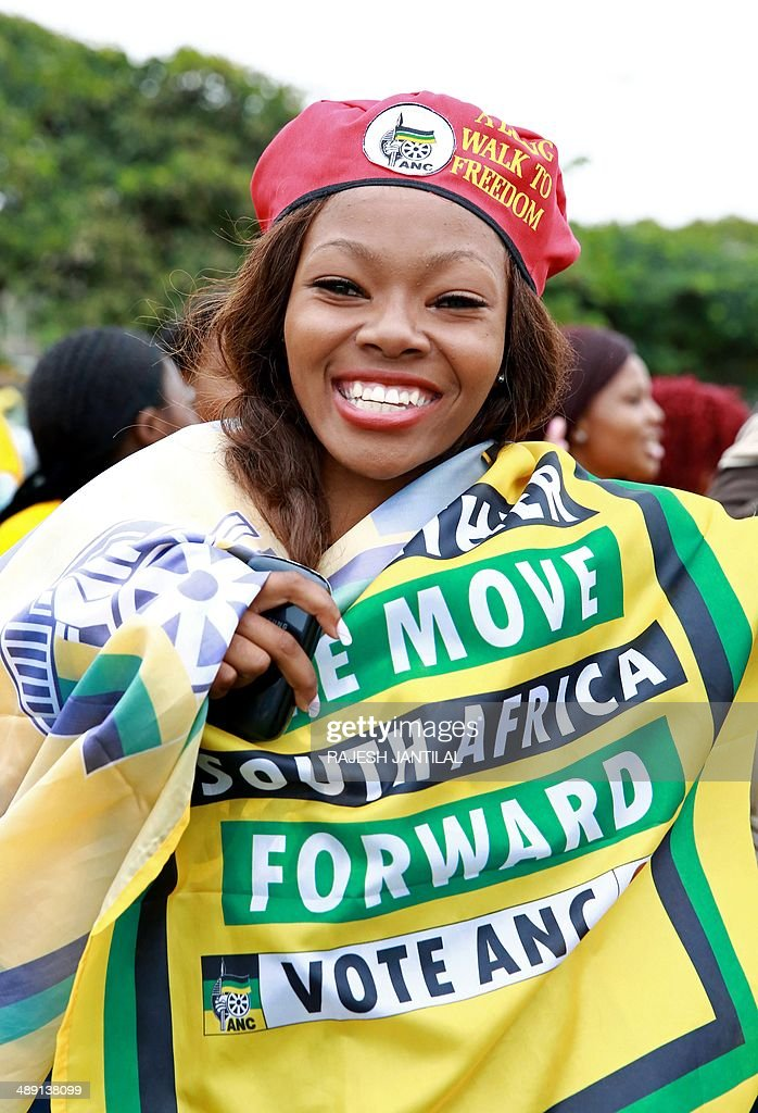 An African National Congress (ANC) supporter reacts during the victory celebrations of the ANC at the Peoples Park outside the Moses Mabhida Football stadium in Durban on May 10, 2014. Completed results showed the African National Congress won 62.15 percent of the ballots, while the main opposition Democratic Alliance came in second with 22.23 percent. AFP/ PHOTO