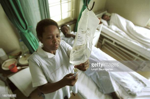 AFRICA MARIANNHILL An African nurse adjusts the intravenous drip of the infusion of a patient in a hospital room in St Marys Hospital in Mariannhill...