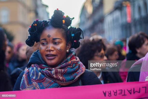 An african origin woman during a rally as part of a nationwide 'Lotto Marzo' protest on the International Women's Day 2017 in Torino Italy on March 8...
