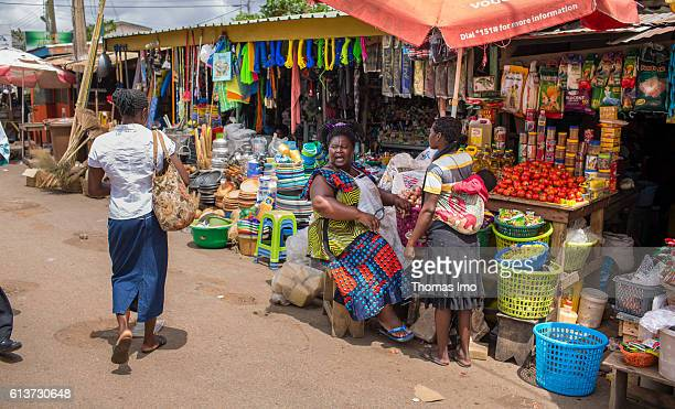 An African street trader has a conversation with a customer at her market stall on September 08 2016 in Accra Ghana