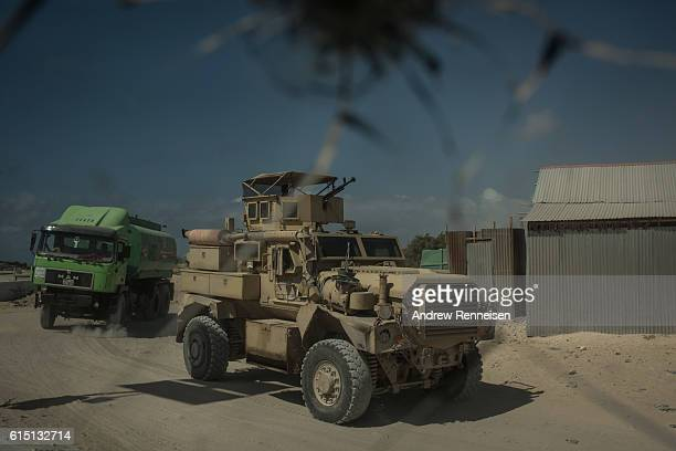 An African Union armored personnel carrier moves through the street on October 13 2016 in Mogadishu Somalia Somalia is on the brink of its first...