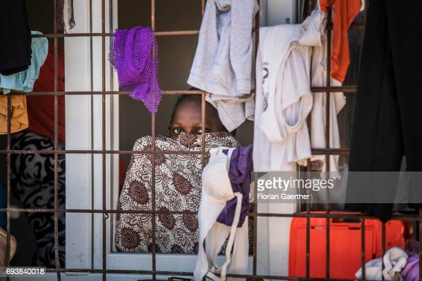An African woman is pictured in a Detention Center on June 08 2017 in Tripolis Libya A detention center place where illegal migrants are arrested
