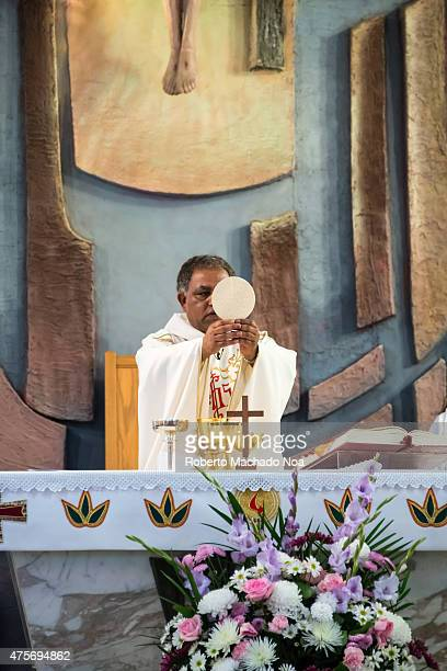 An AfricanAmerican priest delivers a religious ceremony in traditional vestments