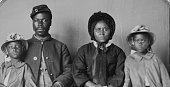 African American soldier in uniform wife in dress and hat and two daughters wearing matching coats and hats In May 1863 US Secretary of War Edwin...